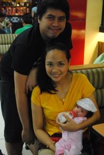 Weeks-old Kaitlyn Jillian with mom and dad